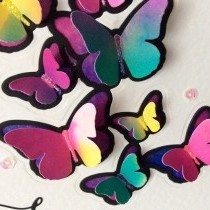 Two contrasting cards with a Spellbinders butterfly die