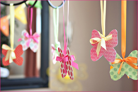Paper butterflies hanging from ribbons
